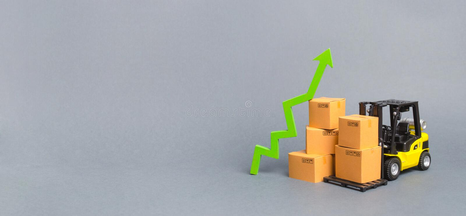 Forklift truck with cardboard boxes and a green arrow up. growth rate of production goods and products, economic raise. Increasing consumer demand. exports royalty free stock images