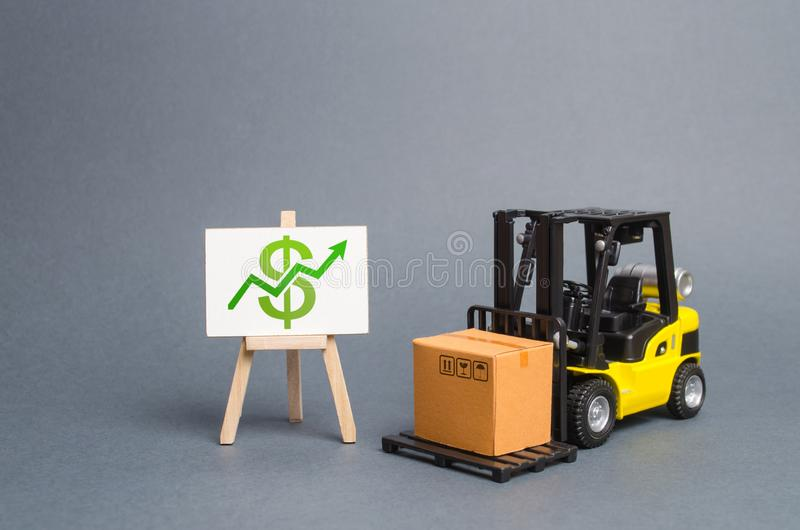 Forklift truck carries a cardboard box and a stand with a green arrow up. Profit growth from sales and high production of goods. Retail, resale, sales of royalty free stock photography