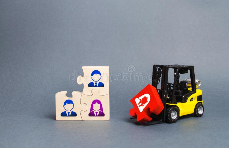 A forklift truck carries a red puzzle to the unfinished assembly of business team. Search, recruitment staff, hiring leader. Creating an efficient and royalty free stock images