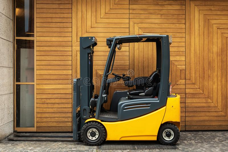 Forklift Truck in Storage Warehouse Ship Yard, Vehicle Factory and Distribution Machine for Products Delivery. Business Industrial. Shipping and Logistics stock image