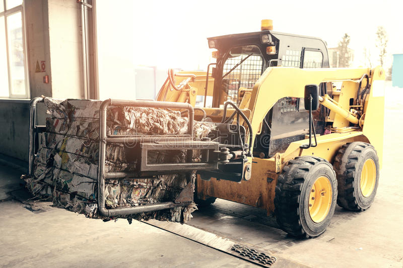 Forklift truck. Waste processing plant. Technological process. Recycling and storage of waste for further disposal royalty free stock photography