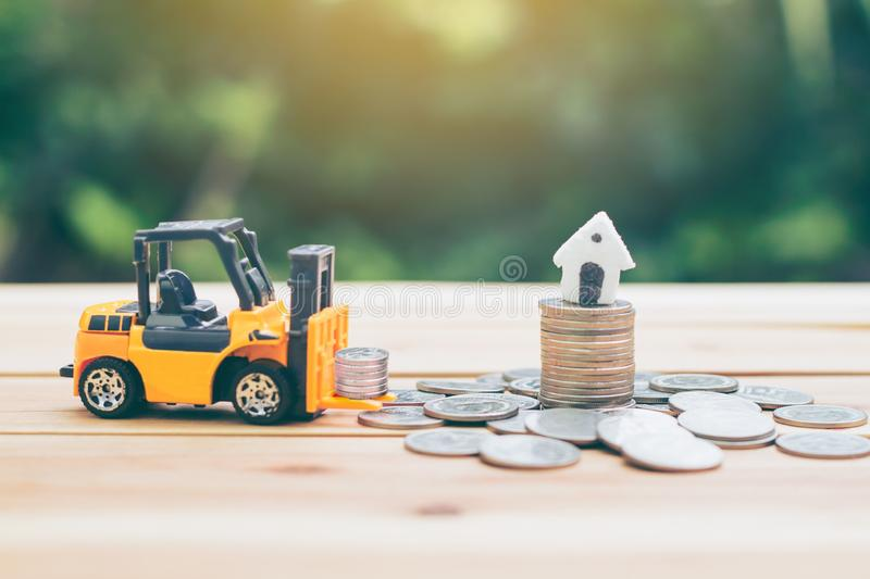 Forklift trucks that are carrying money to put fund. means the growth of the business. stock image