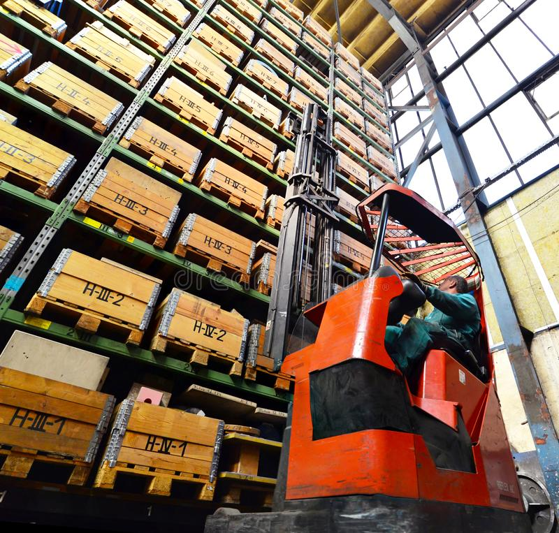 Forklift trucks in a high-bay warehouse - storage of goods in an industrial company. Closeup stock photography