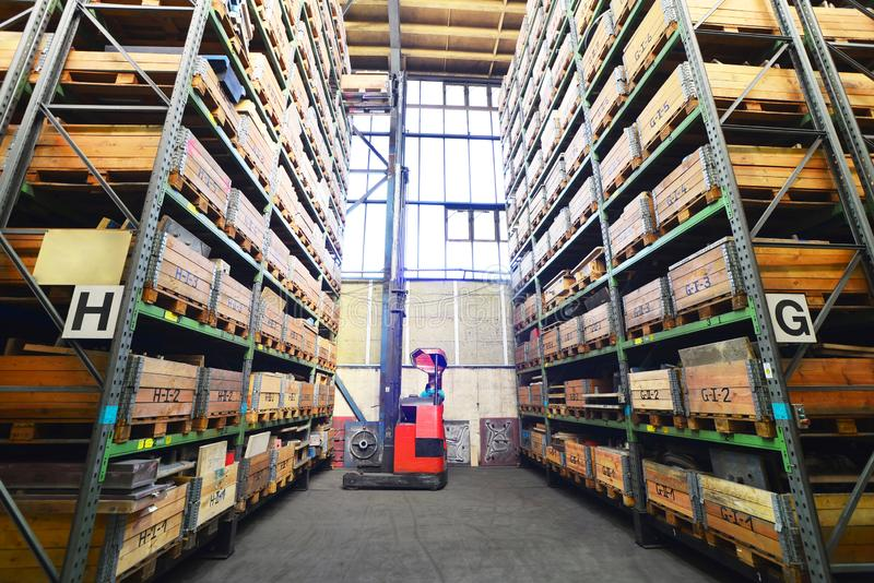 Forklift trucks in a high-bay warehouse - storage of goods in an industrial company. Closeup photo stock photo