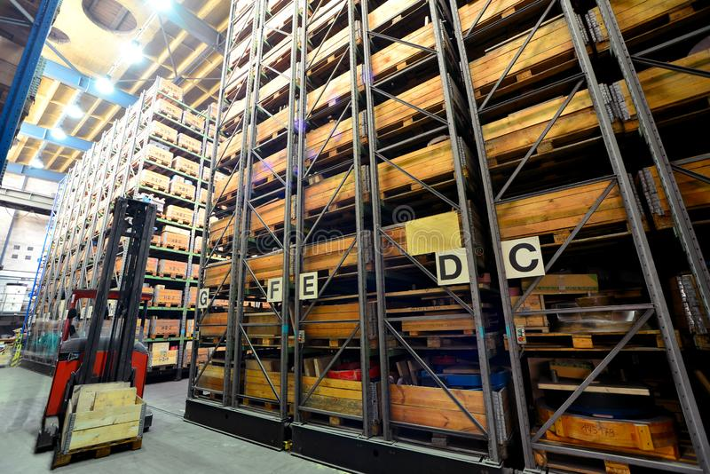 Forklift trucks in a high-bay warehouse - storage of goods in an industrial company. Closeup photo stock photos