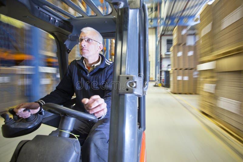 Forklift w magazynie obrazy royalty free