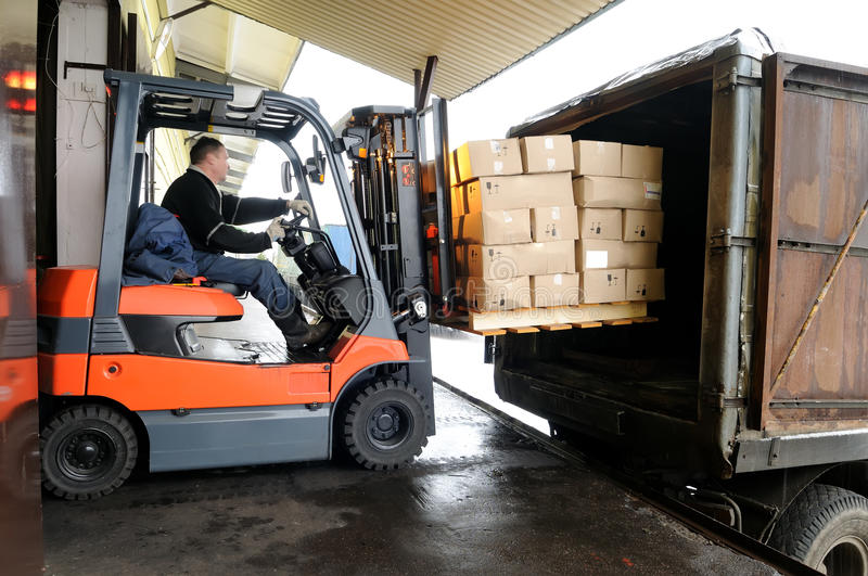 Forklift in warehouse stock photography