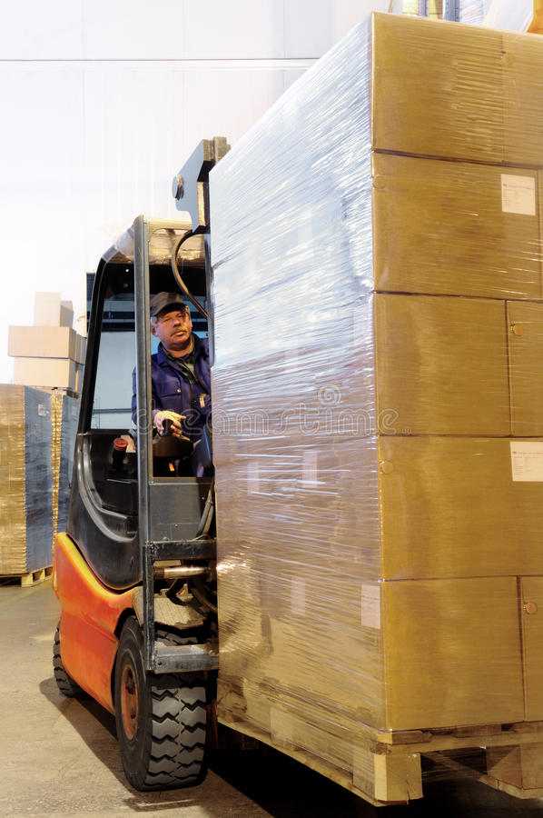 Forklift worker in loader at royalty free stock image