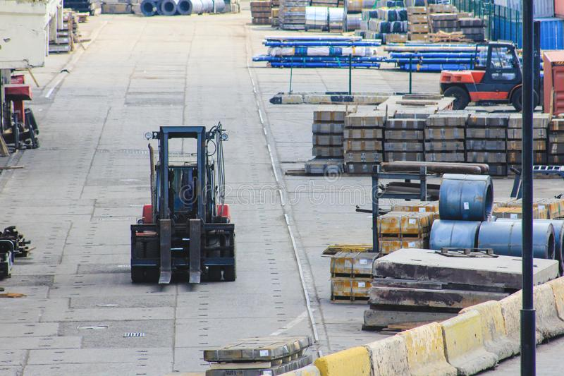 Forklift works in an open warehouse in the seaport. stock photography