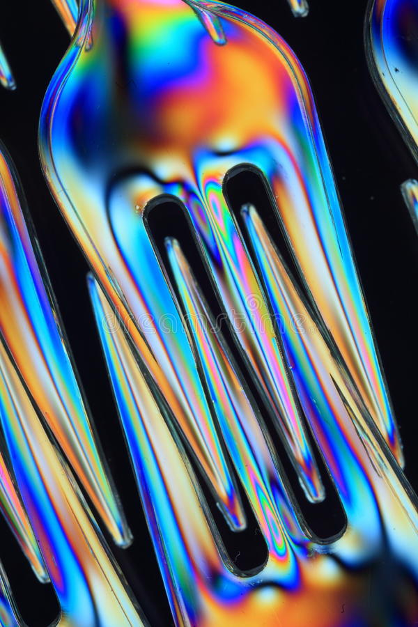 Forks. Close-up of plastic forks seen through polarized light stock photos