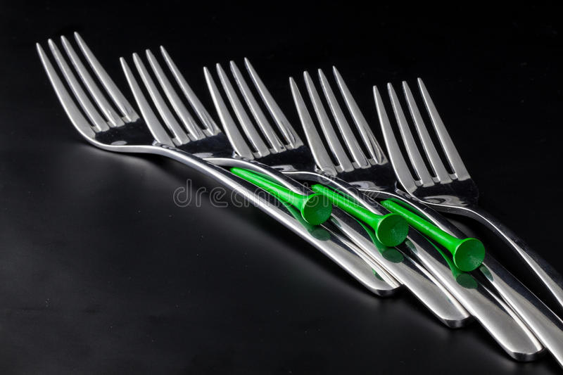 Forks on a black table stock image