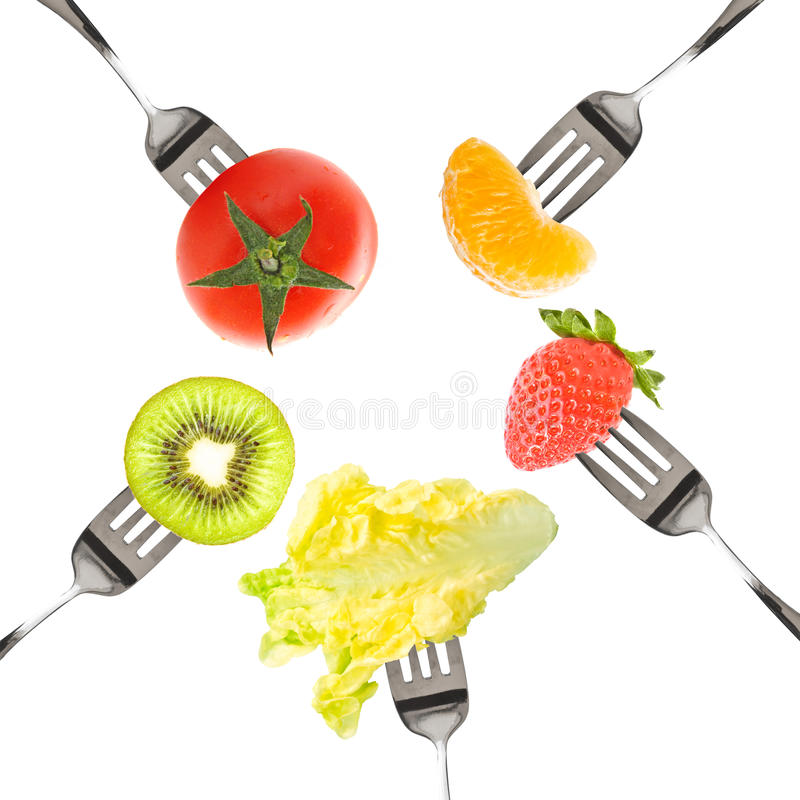 Forks with fruits and vegetables isolated on white stock photography
