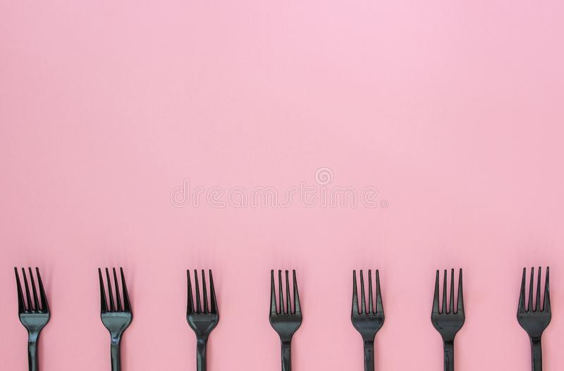 Forks on a pink background. Minimal concept. Abstract royalty free stock images
