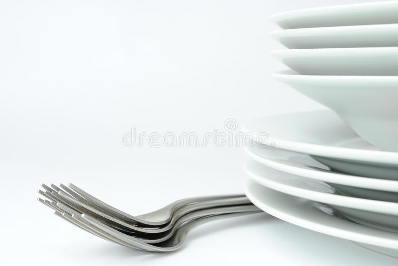 Forks and plates stock image