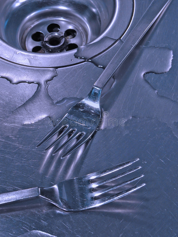 Forks in a sink stock image