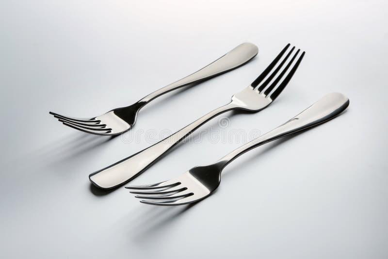 Forks on white background stock photos