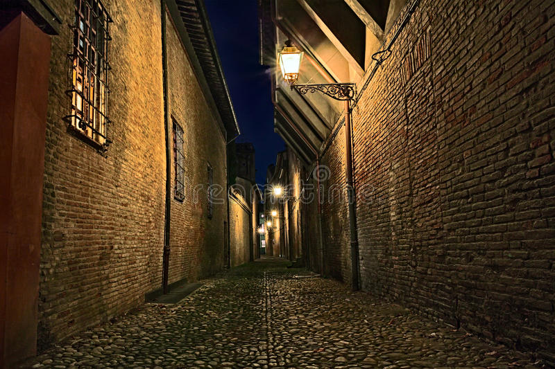 Forli, Emilia Romagna, Italy: dark alley in the old town. Forli, Emilia Romagna, Italy: narrow dark alley in the old town - ancient Italian street at night with royalty free stock photography