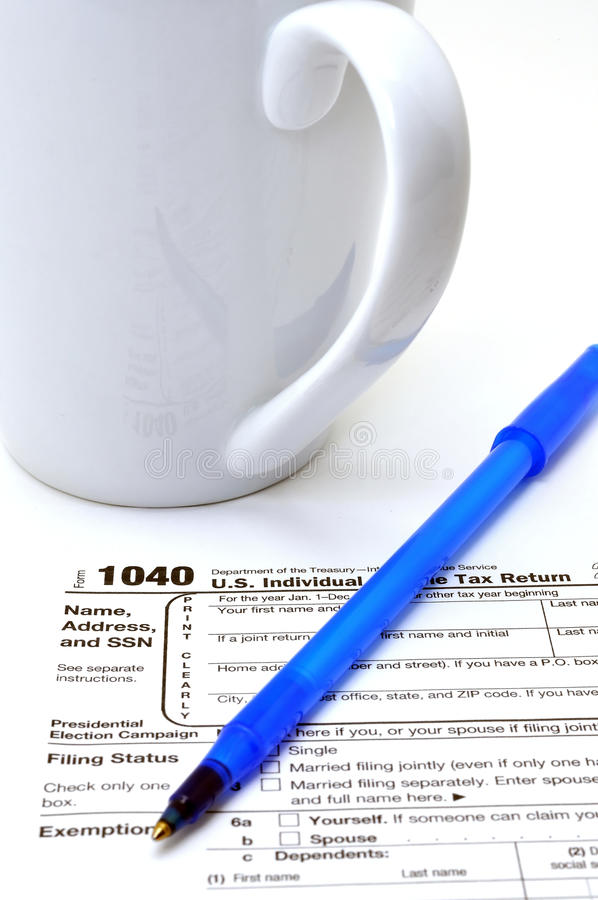 Form 1040. Closeup of IRS form 1040 on white background stock image