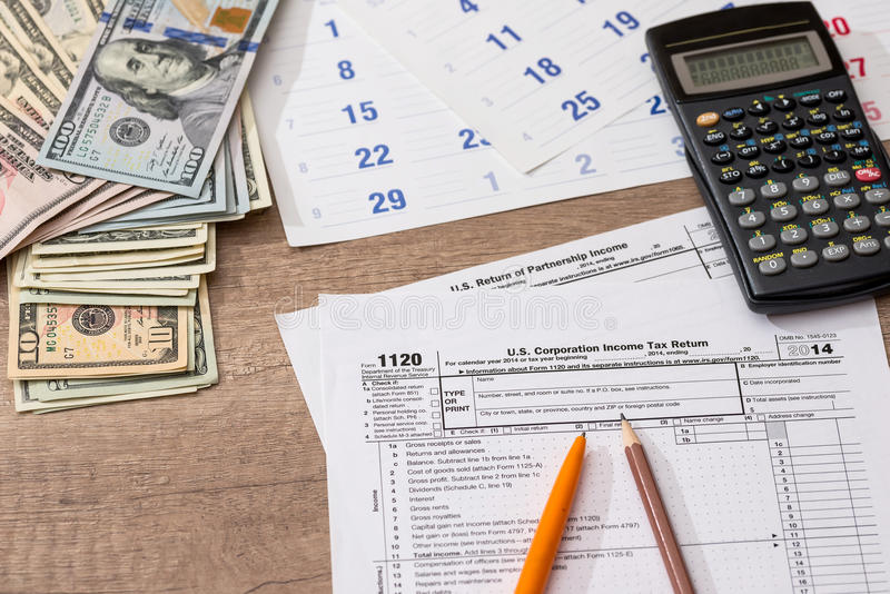 Form 1120 Corporate Tax Return with Calendar, Calculator and Pen royalty free stock images