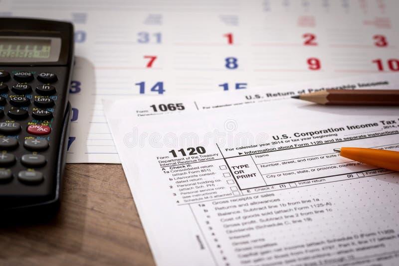 Form 1120 Corporate Tax Return with Calendar, Calculator. And Pen stock photos