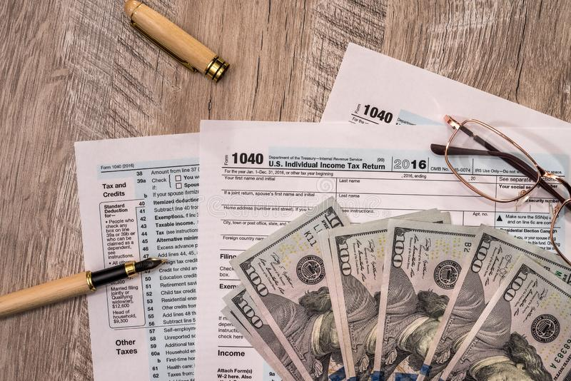1040 form with dollar, spectacles and pen.  royalty free stock image