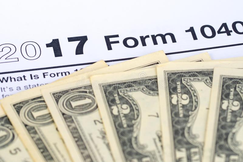 2017 form 1040 with dollars. 2017 form 1040 with dollar banknotes stock photos
