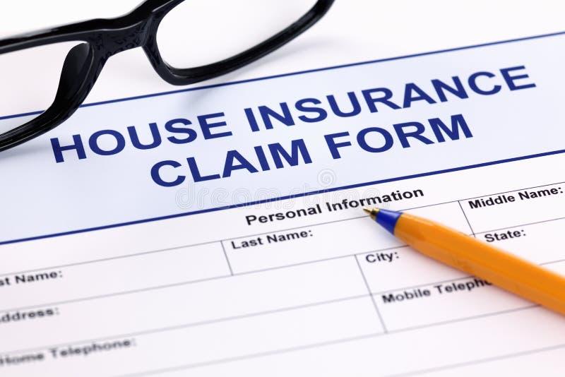 Form för husförsäkringreklamation arkivbild
