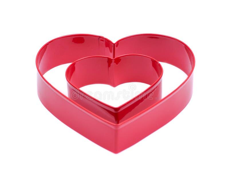 Form för skärare för kaka för hjärtaShape fördjupning plast- för att dekorera för bakning för kakabakelseefterrätt som isoleras p royaltyfri bild