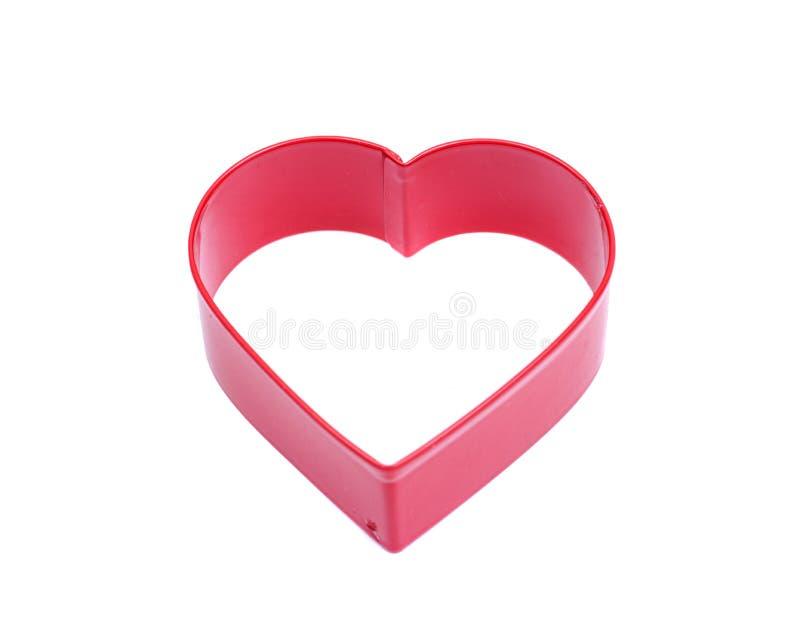 Form för skärare för kaka för hjärtaShape fördjupning plast- för att dekorera för bakning för kakabakelseefterrätt som isoleras p arkivbild