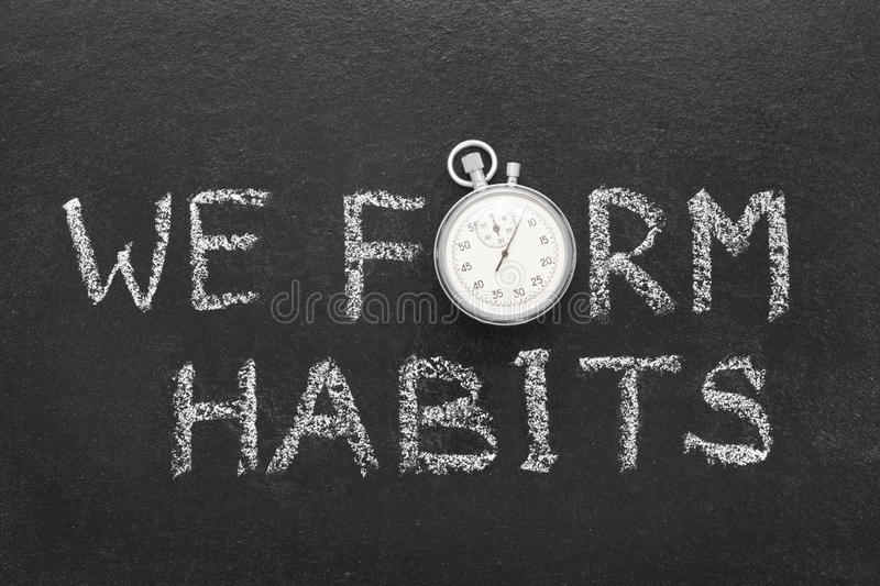 We form habits watch. We form habits phrase handwritten on chalkboard with vintage precise stopwatch used instead of O royalty free stock photo