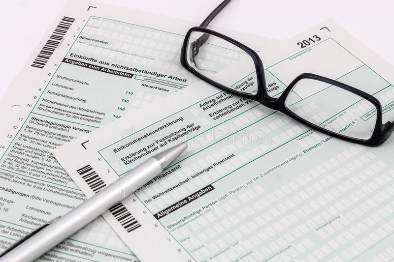 Form of income tax return with pen and glasses. Form of income tax return with ball pen and glasses stock photography