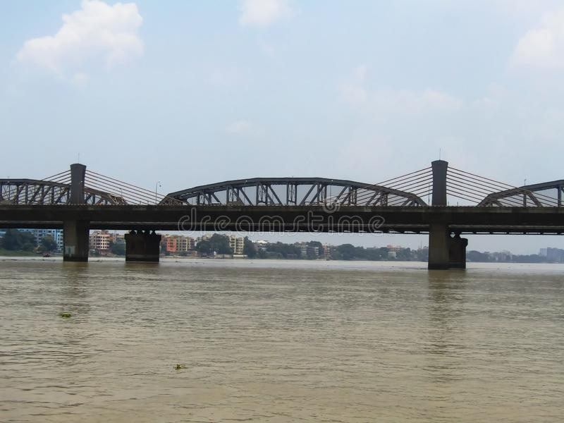 Modern and anciant steel structure in bridge technology.. Form the middle of the river view of an anciant bridge in Kolkata, locally called Bally Bridge royalty free stock photo
