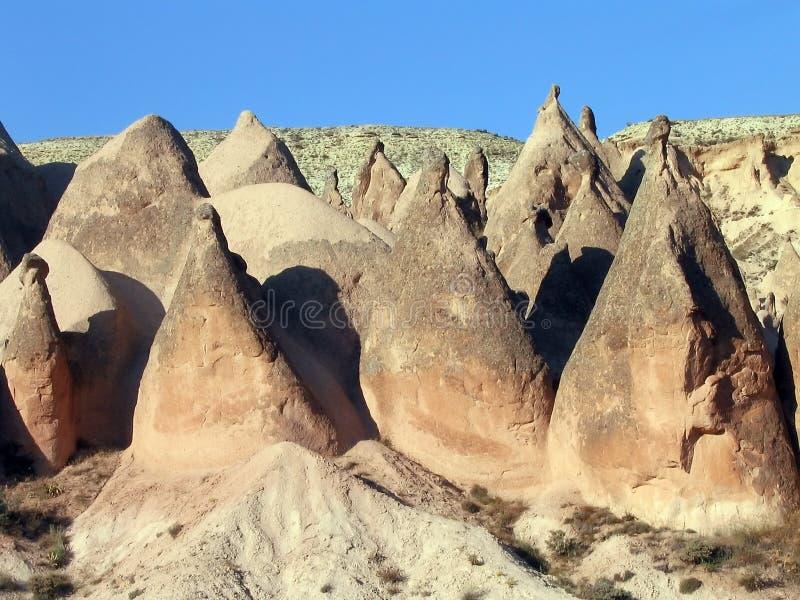 Formações de rocha cónicas, Cappadocia, Turquia imagem de stock royalty free