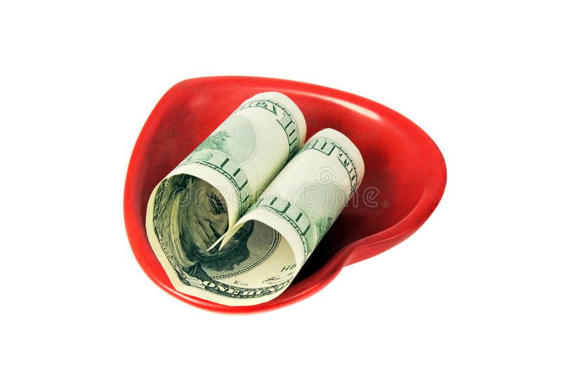 Forma americana del dinero un corazón imagen de archivo libre de regalías
