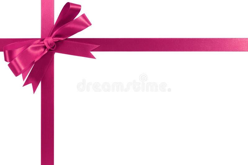 Forma cruzada de la esquina horizontal de la cinta rosada del regalo foto de archivo
