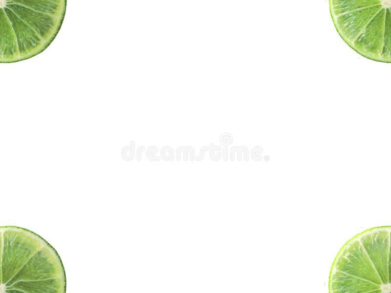 Forma cuarta de la rebanada jugosa de la cal en la esquina aislada en el fondo blanco imagen de archivo libre de regalías