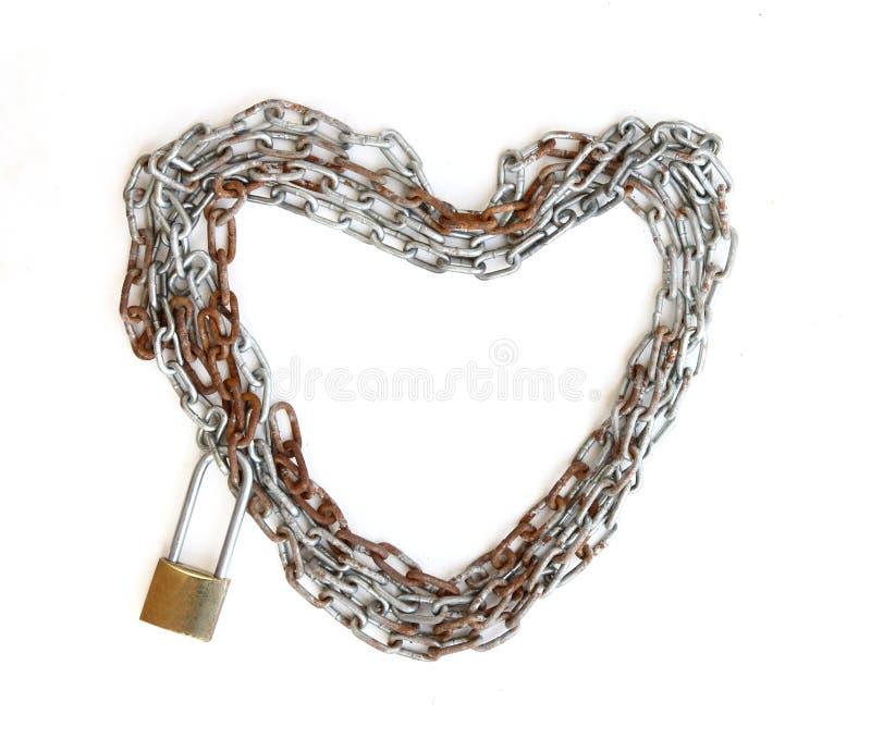 Forma de cadena del corazón con el bloqueo de teclas principal fotos de archivo libres de regalías
