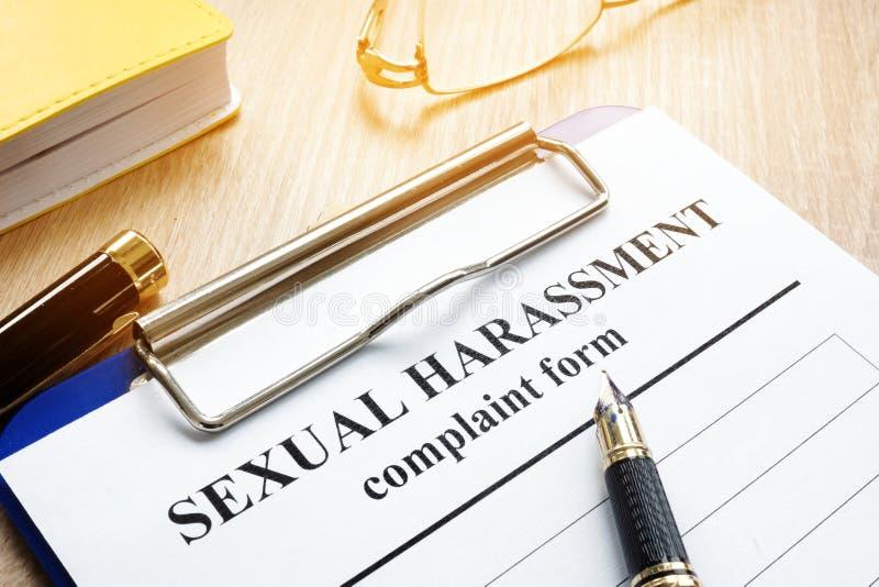 Forma de la denuncia del acoso sexual imagen de archivo