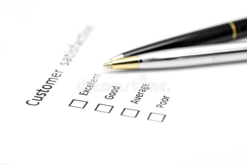 Forma de la encuesta sobre la satisfacción del cliente con la pluma fotos de archivo libres de regalías