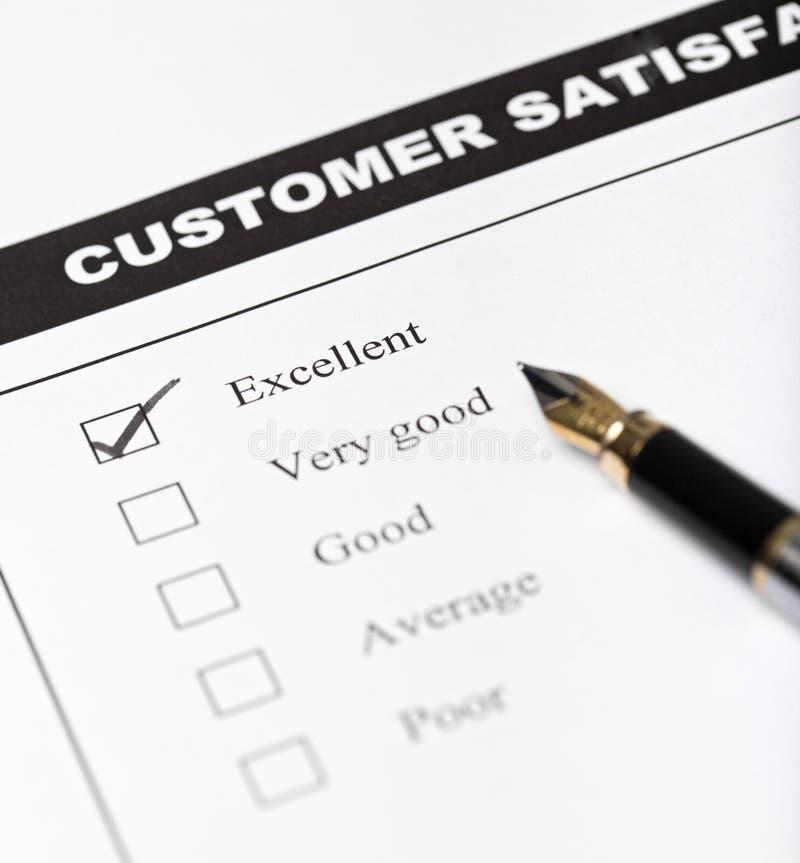 Forma de la encuesta sobre la satisfacción del cliente - primer foto de archivo libre de regalías