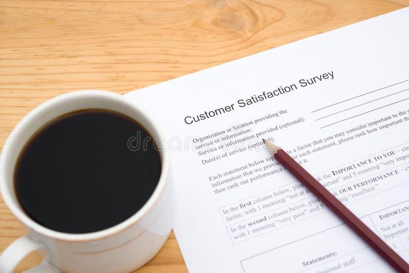 Forma de la encuesta sobre la satisfacción del servicio de atención al cliente foto de archivo libre de regalías