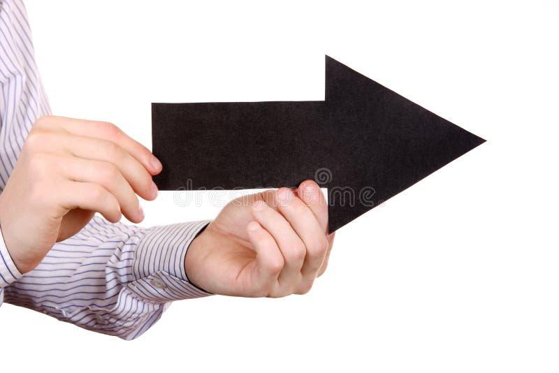 Forma de la flecha del negro del control de la persona fotos de archivo