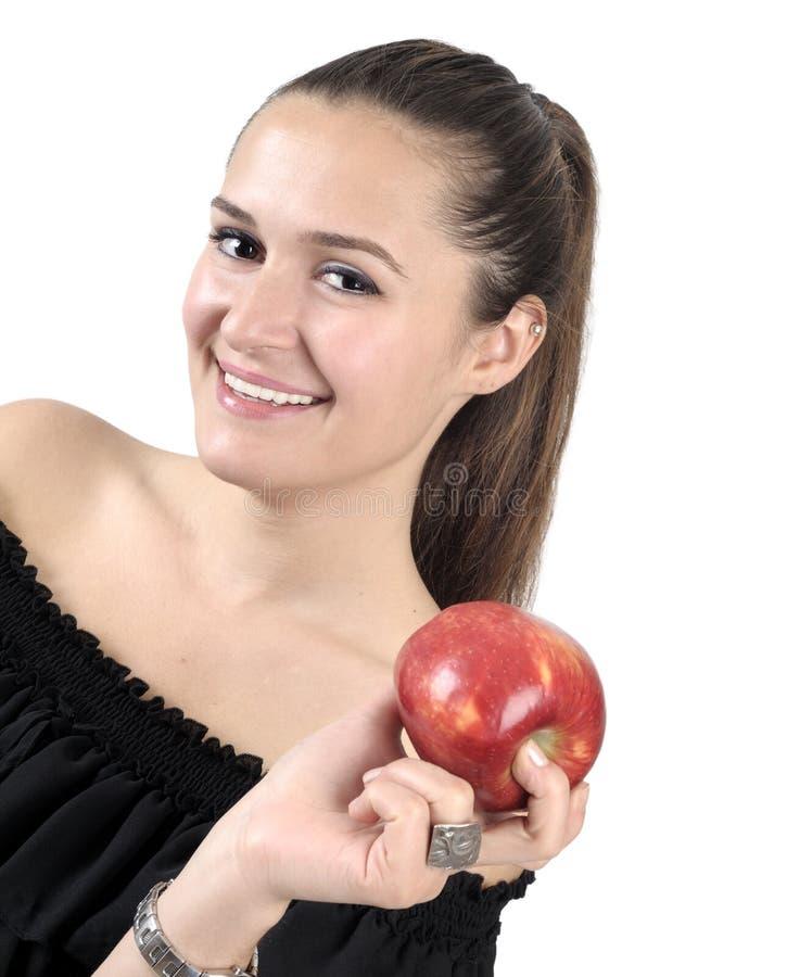 Forma de vida sana - mujer y manzana sonrientes felices imagen de archivo
