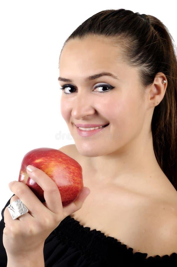 Forma de vida sana - mujer y manzana sonrientes felices imagen de archivo libre de regalías
