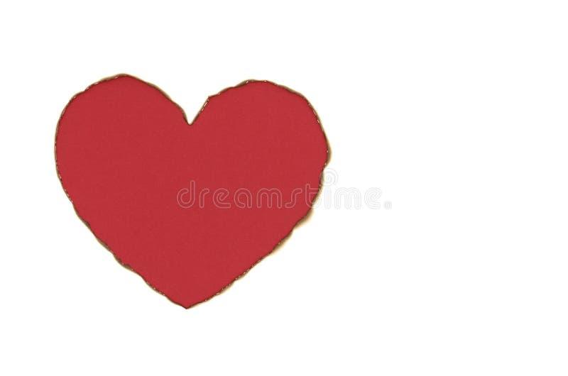 Forma del amor del corazón del color rojo con el Libro Blanco quemado foto de archivo