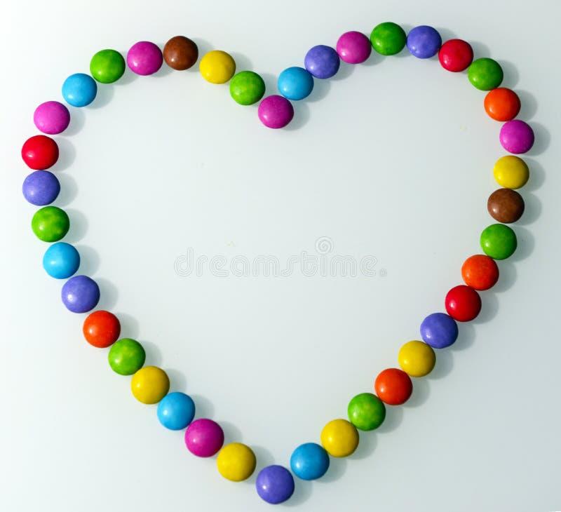 Forma del corazón formada con el caramelo fotografía de archivo libre de regalías