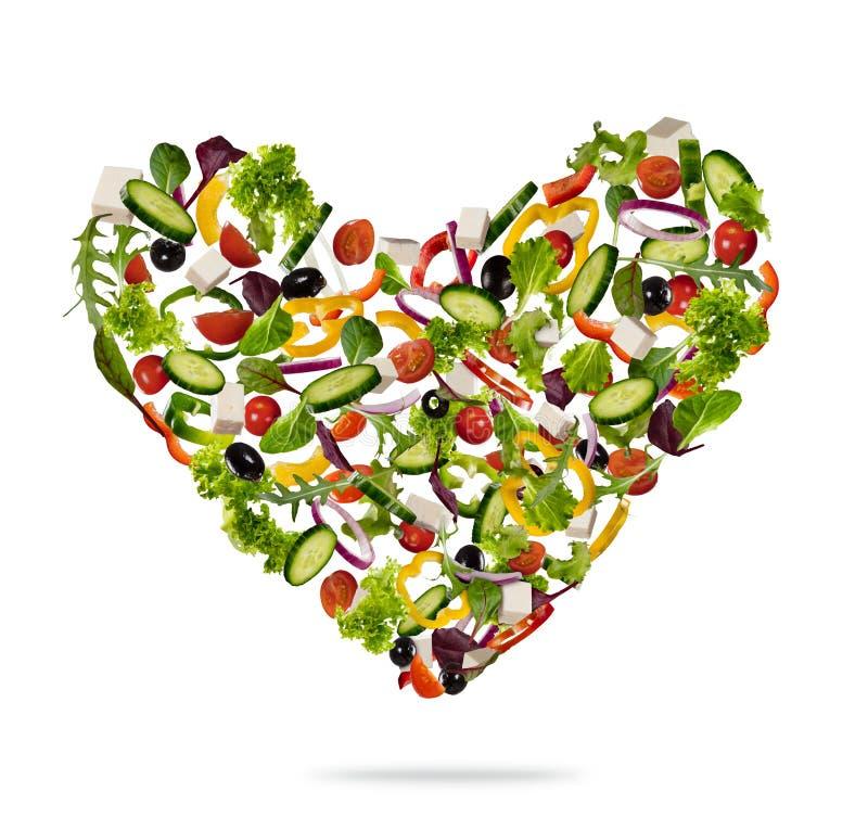 Forma del corazón hecha de la diversa clase de verdura en blanco stock de ilustración