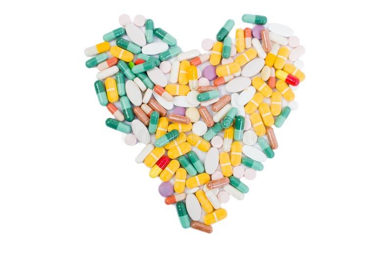 Forma del corazón hecha de píldoras imagen de archivo libre de regalías