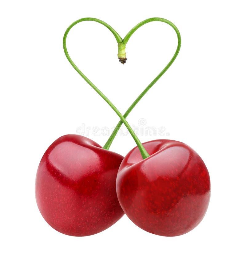 Forma del cuore da due ciliege sopra bianco fotografia stock
