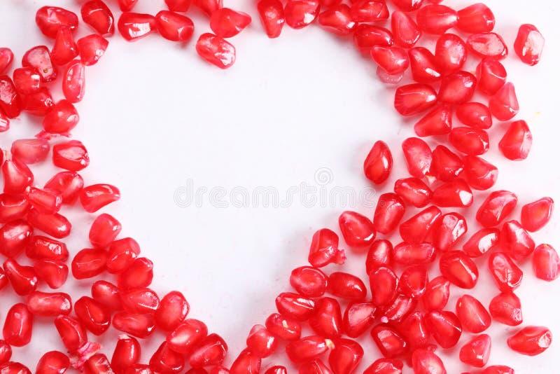 Forma del cuore del seme del melograno immagine stock libera da diritti